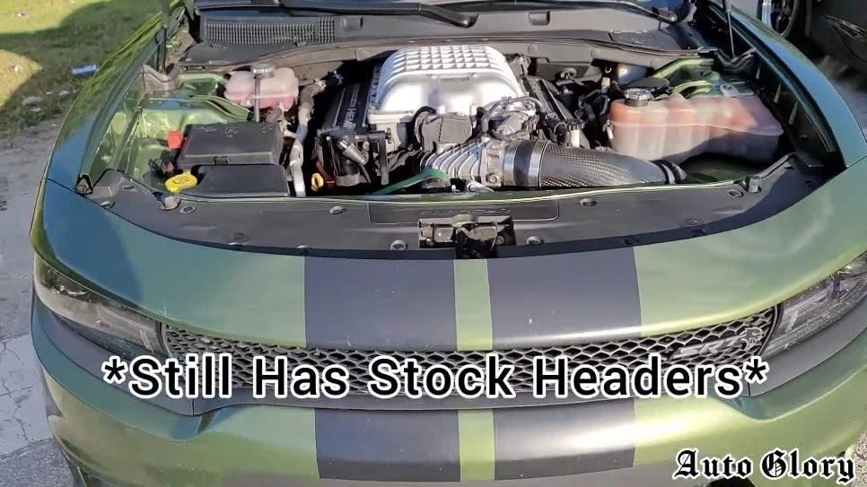 Dodge Charger SRT Hellcat vs Chevrolet Camaro SS drag race